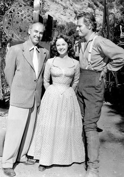 Author Irving Stone, Susan Hayward and Charlton Heston on the set of The President's Lady