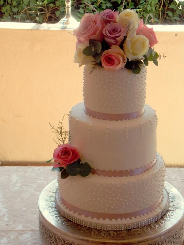 Pink dusty rose cake with real flowers and dots