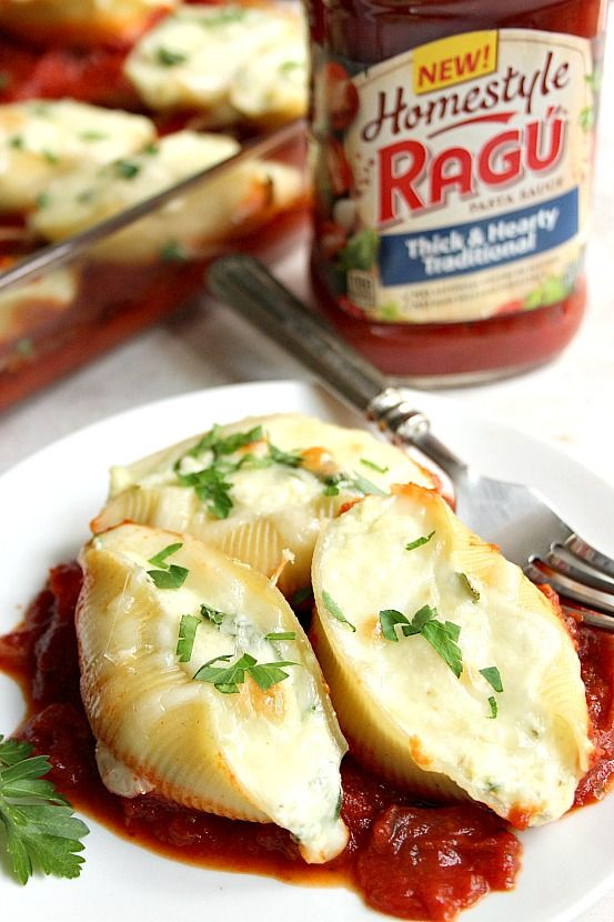 Spinach and Ricotta Stuffed Pasta Shells recipe - rich and hearty pasta dish that's easy to make! Jumbo pasta shells filled with creamy ricotta and spinach filling, topped with more cheese and baked on top of hearty red sauce.  #ad  #sponsored Sponsored by Mirum Shopper.