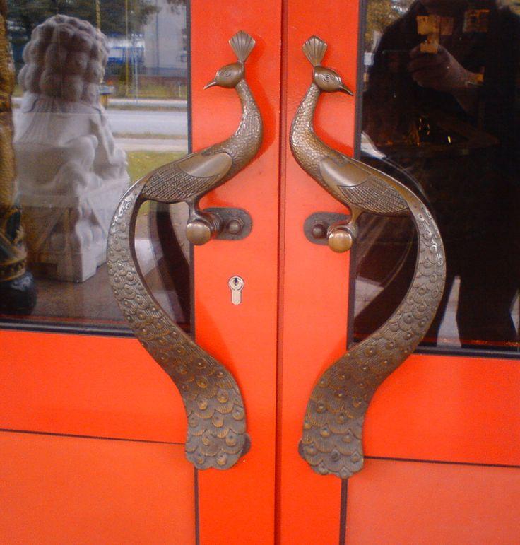 Peacock door handles for Chinese restaurant, posted via doorsdarling.com -- door pulls bird animal nature