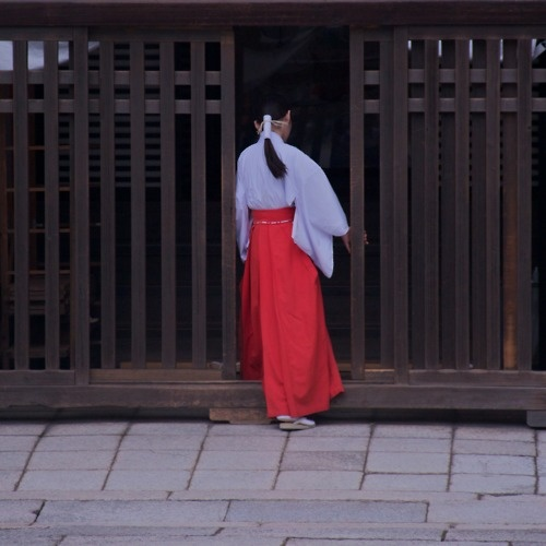 Miko in Kyoto, Japan: a maiden who conducts ceremonies to worship gods at a shrine.