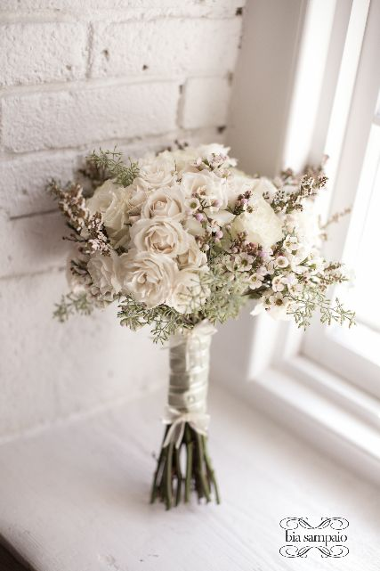 textural display of roses, spray roses, wax flower, heather and seeded eucalyptus berries