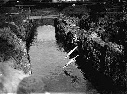 """Boys swimming in water hole behind the conservatorium."" Sydney Morning Herald photo c 1920s. The 'water hole' is actually the cutting for the City Circle railway line."
