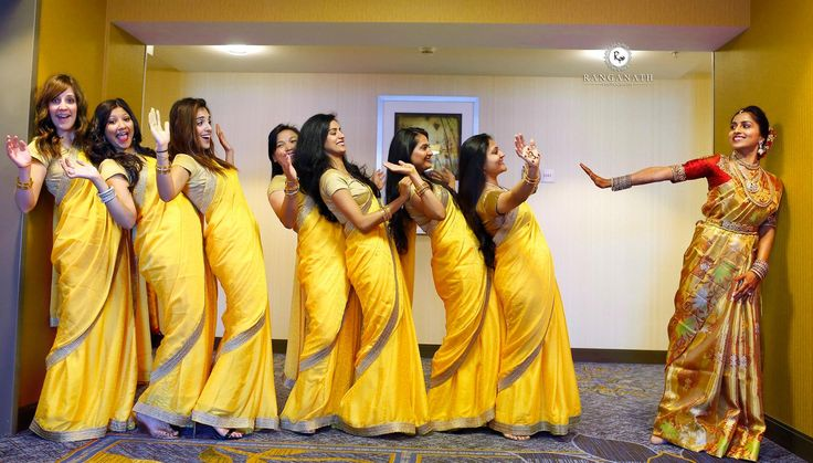 South Indian bride. Temple jewelry. Jhumkis.red silk kanchipuram sari.Braid with fresh flowers. Tamil bride. Telugu bride. Kannada bride. Hindu bride. Malayalee bride.Kerala bride. Bridesmaids saris