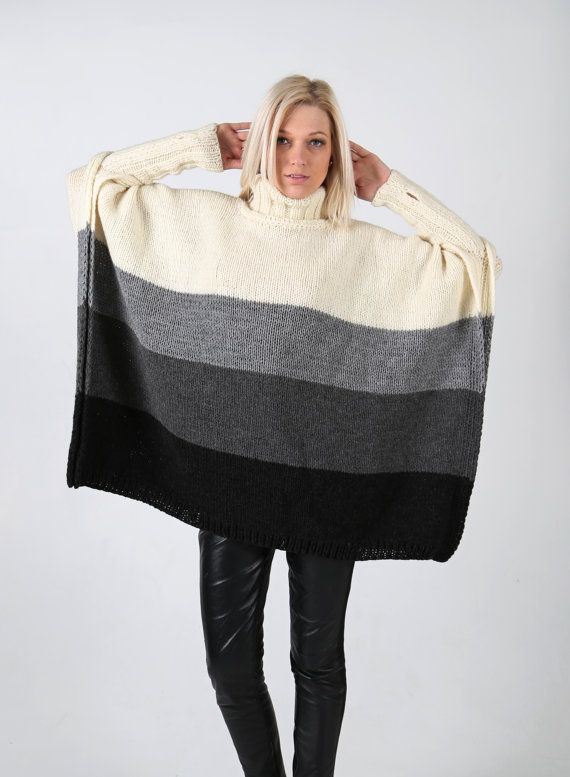 Hand knitted four colour poncho with long sleeves and high collar. Handmade knit.