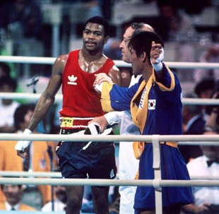 24-years-ago this autumn on October 1, at the 1988 Summer Olympics in Seoul, South Korea, a 19-year-old Roy Jones, Jr. destroyed South Korean boxer Park Si-Hun for three rounds only to lose a disgusting 3–2 decision and merely win the silver medal. Prior to embarrassing Si-Hun, Jones, with his blazing speed and ferocious left hooks, outclassed all competitors and never surrendered a single round en route to the corrupt final.