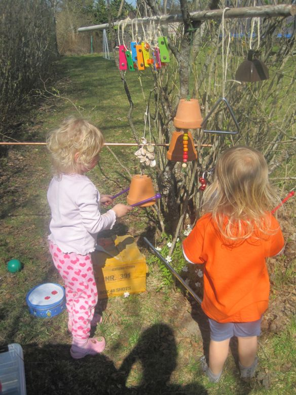 A music tree outside in nature constructed using loose parts that could be found around any household! The outcome looks exciting and fun