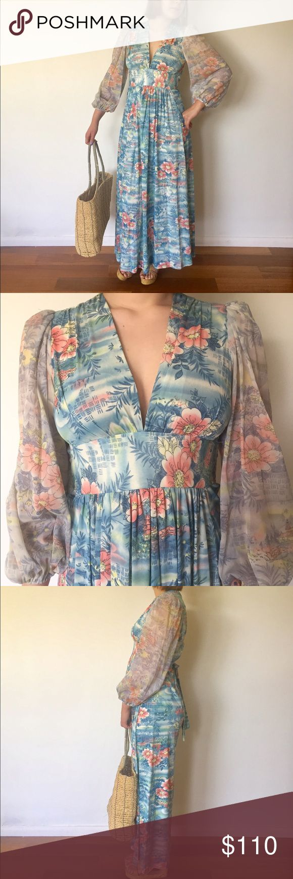 "60s 70s Maxi Dress Sheer V Neck Asian Print S M 70s Empire waist dress with sheer bell sleeves. The neckline has a deep V design, it has a cinching tie at the waist, the sleeves have elastic ends.  It goes on over the head with no zipper.    Material: Polyester Color/print: blue with peach and yellow Asian print Maker: tag says Union Made Era: 70's  Size:  M  Bust- 34""  Sleeve- 24"" Waist- 30"" with cinching tie Hips- 60"" Length- 54"" 1/2"" of STRETCH ON EACH SIDE Model-5'4"" 34""B 26""W 38""H…"