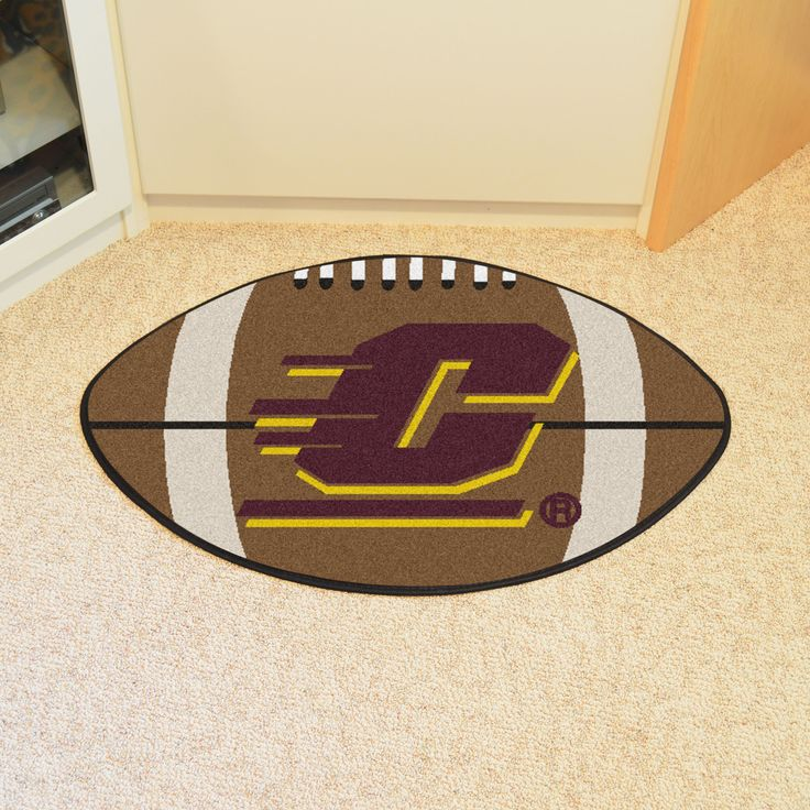 """Central Michigan University Football Rug 20.5x32.5 - For all those football fans out there: football-shaped area rugs by FANMATS. Made in U.S.A. 100% nylon carpet and non-skid recycled vinyl backing. Machine washable. Officially licensed. Chromojet printed in true team colors.FANMATS Series: FOOTBALTeam Series: Central Michigan UniversityProduct Dimensions: 20.5""""x32.5""""Shipping Dimensions: 22""""x18""""x0.5"""". Gifts > Licensed Gifts > Ncaa > All Colleges > Central Michigan University. Weight: 1.40"""