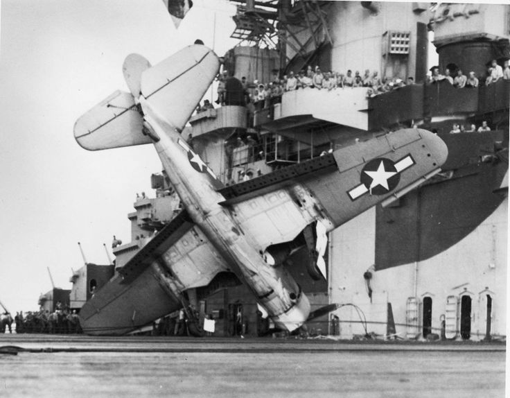A Curtiss SB2C-3 Helldiver of the 7th Bombardment Squadron after an emergency landing on the aircraft carrier USS Hancock during the Battle of Leyte Gulf.