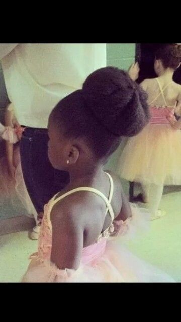 Natural young ballerina. That thick bun is everything!!!