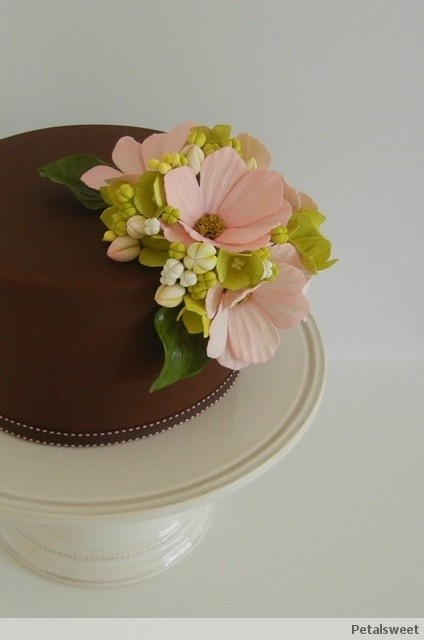 Single tier covered with chocolate fondant and decorated with pink cosmos, hydrangea, buds and leaves...by Petalsweet.