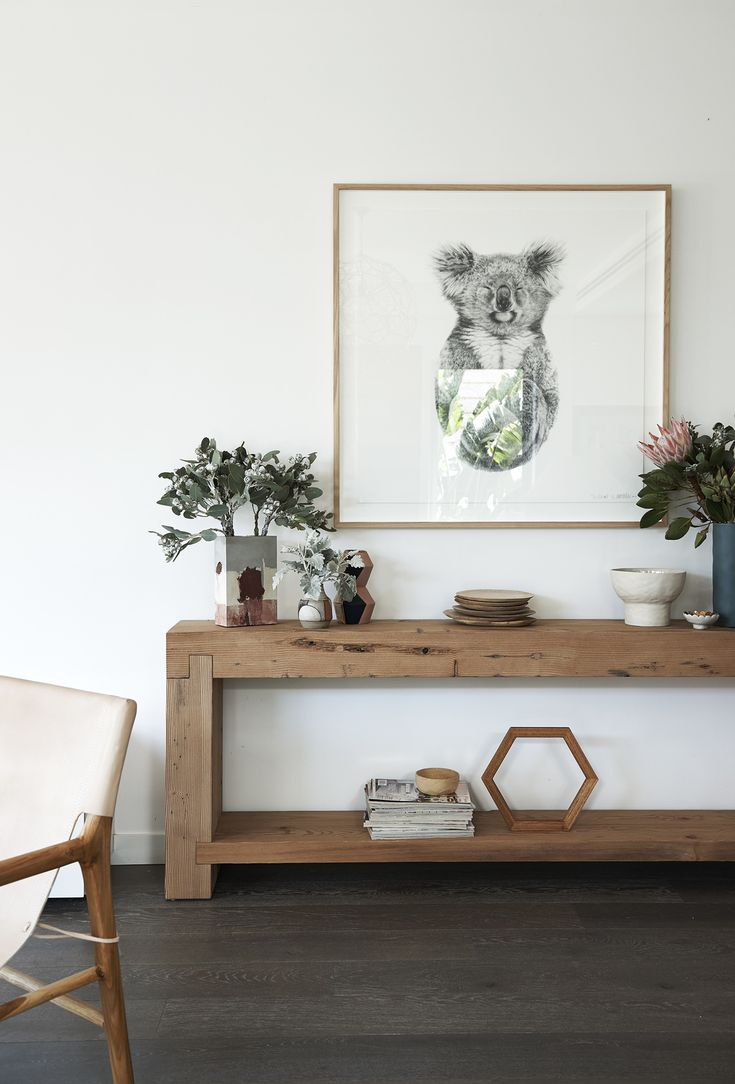 A beautifully chunky Mark Tuckey console table is filled with ceramics by Marmouset Found and Studio Twocan. Above hangs 'The Alchemist' limited edition print by Carla Fletcher. A stack of mango plates from the House of Orange and a custom made timber hexagon were stained with Feast Watson's Traditional timber oil.