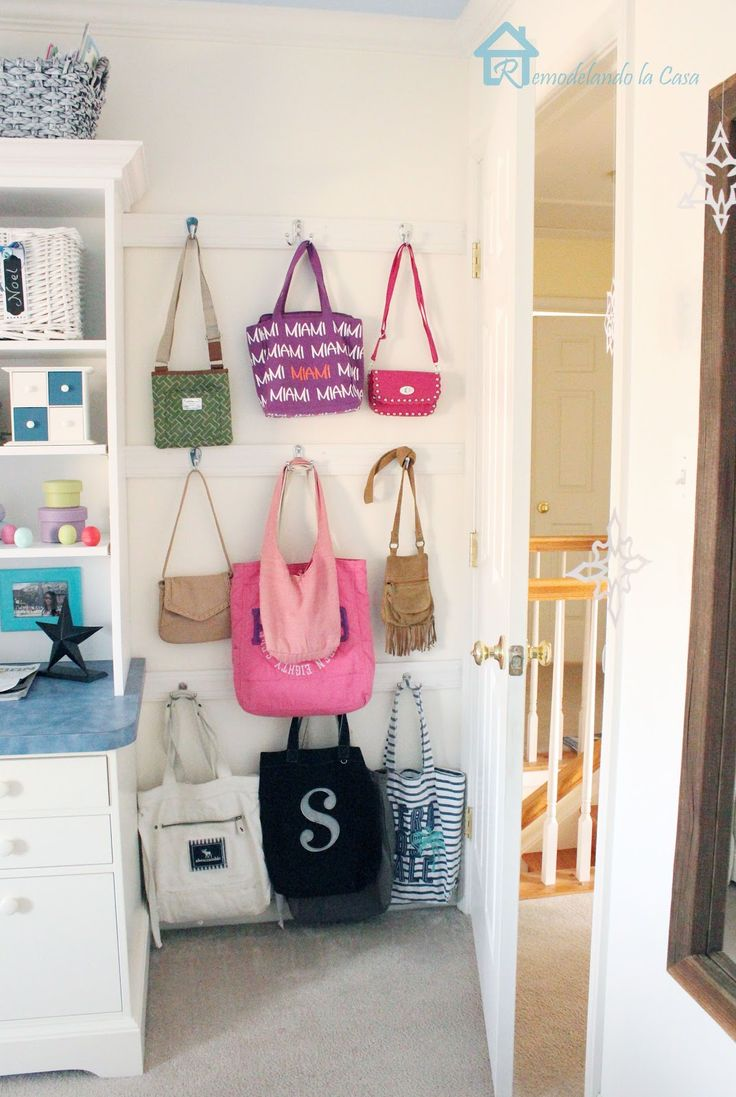 Add simple pieces of moldings with hooks behind door and you'll have extra storage for bags.