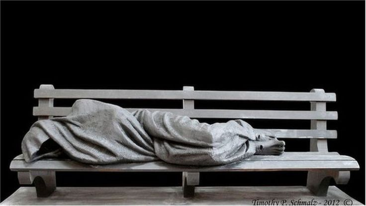 The sculpture of Jesus as a homeless man is displayed in Glasgow alongside a Peter Howson painting.