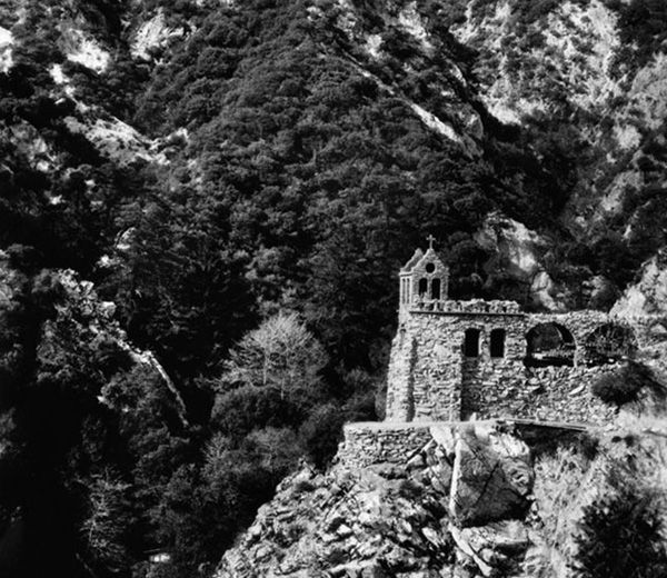 The first tourist resort built in the San Gabriels boasted one of the most incredible -- and precarious -- sights in Southern California: the Christ Chapel. Lloyd B. Austin, Switzer-land owner spearheaded the bold development of this house of worship in the Arroyo Seco Canyon. Dedicated in June 1924, the resort chapel was erected on a cliff 200-feet above Switzer Falls.
