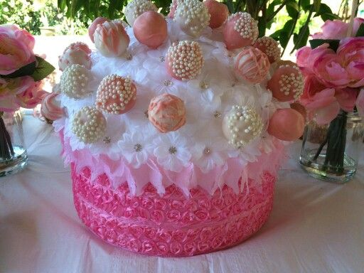 Our cake pop display made out of Styrofoam artificial flowers and ribbon it came out perfect! @castillo2806