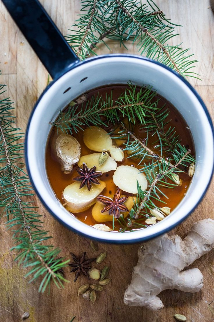 A Long Winter's Nap- A Bourbon cocktail with Maple syrup, fir sprigs, ginger, star anise and lemon. A delicious cozy wintery drink! | www.feastingathome.com