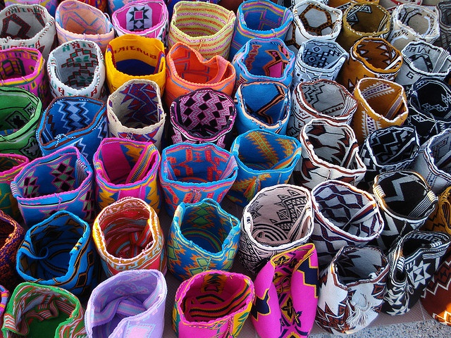 """""""Mochilas Wayuú en Riohacha [Colombia],"""" by jorgeandram, via Flickr.  [""""The Wayuu Mochila bags are made by the Wayuu, a group of indigenous people who live in La Guajira Peninsula in northern Colombia and north west Venezuela. Each mochila is hand-made by one woman and each woman has her own signature."""" http://wayuumochilabags.com/ ]"""