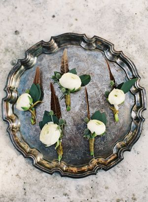 Want one of these for my man. A dark feather and a feminine white flower. Alder Manor Vintage Wedding