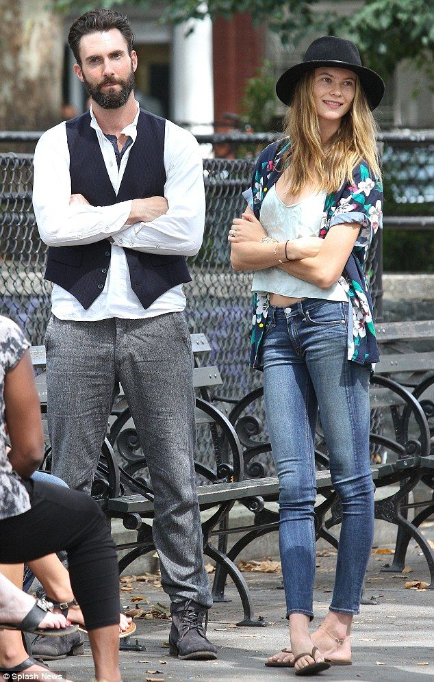 Don't be cross! Levine and Prinsloo fold their arms as he kills time between scenes
