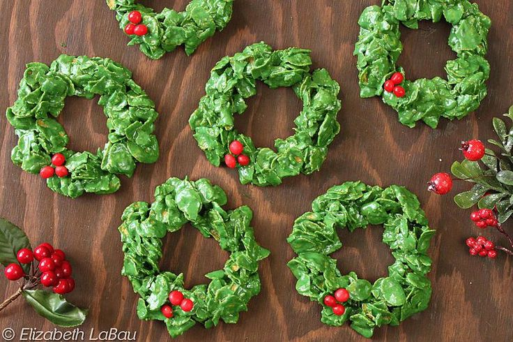 This Easy Corn Flake Wreaths Recipe Is Perfect for the Holidays. Dip fingers in cold water between wreaths to keep them from sticking to you and add the red sweets quickly before mixture cools down 🎄