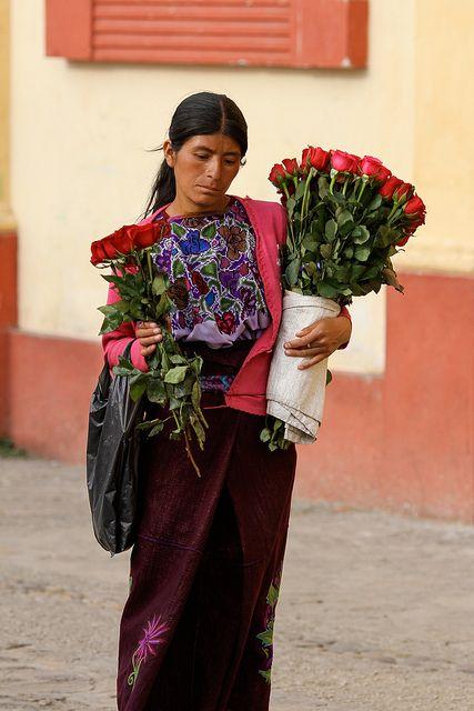 Flower seller. Mexico http://vivirenmexico.tumblr.com/post/51534693347/su-mirada-lo-dice-todo-vendedora-de-flores