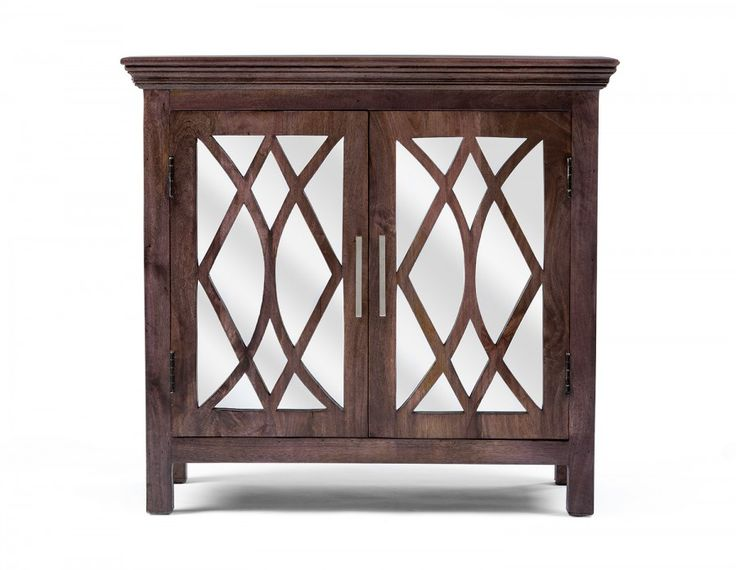 It's easy to see that Georgia exudes elegance, from its stately silhouette to the intricate mirrored doors. Handmade in India from solid mango wood, this piece was hand brushed and polished, giving it a unique  weathered oak finish that is completely water-based and lead-free. Store serving pieces and fine china inside, or use Georgia as a bar for entertaining. Georgia provides the style — you decide on its utility.