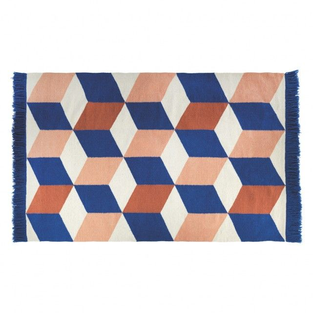 £300  The hand-woven Quadra large blue and pink flat weave rug combines vibrant and tonal colours in a large-scale, repeat geometric pattern.[br]Designed in house and made from a wool-rich blend, the rug is bold, cobalt blue fringing and a Quadra cushion is also available.