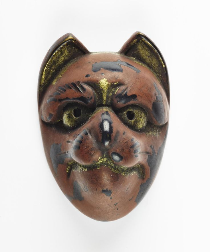 Netsuke of wood, the mask of a cat-like animal lacquered in red, black and gold: Japan, 19th century
