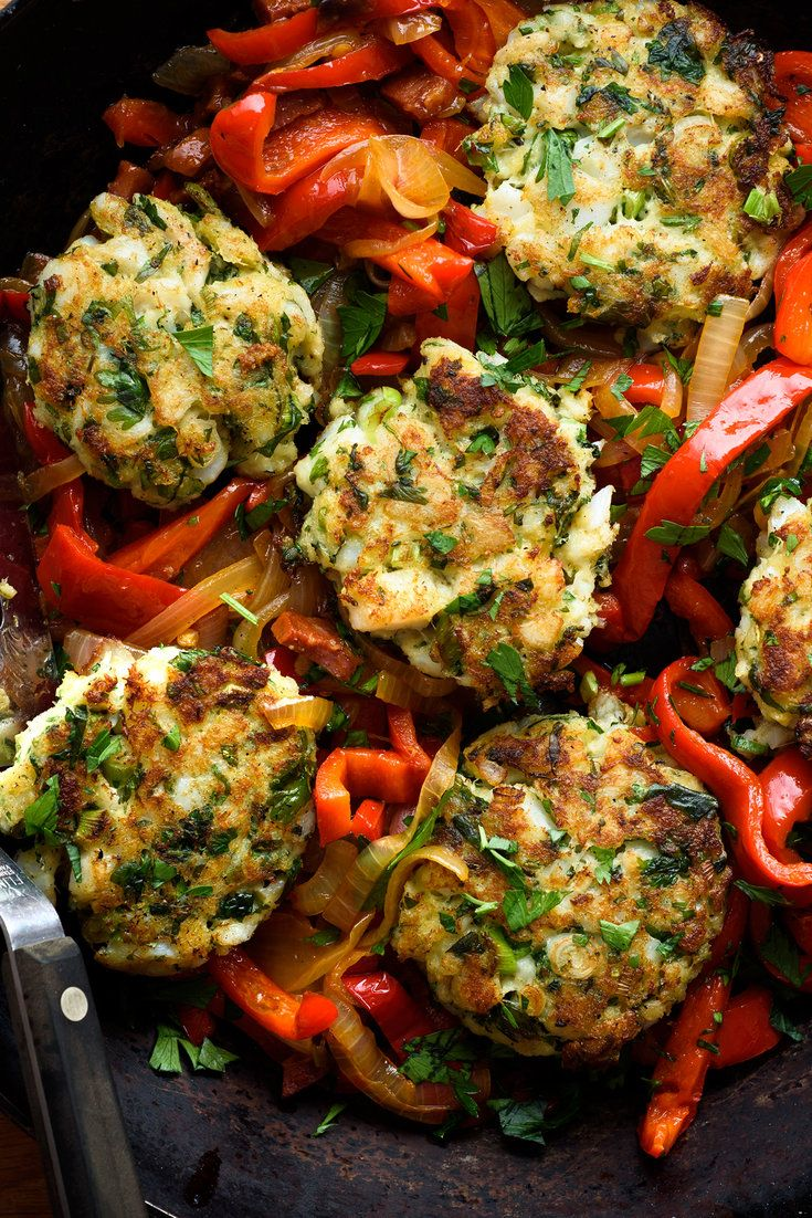 Codfish cakes with sweet peppers, onions and chorizo. (Photo: Karsten Moran for The New York Times)