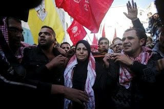 News about PFLP: Thousands march to mourn the martyr, Comrade Khale...