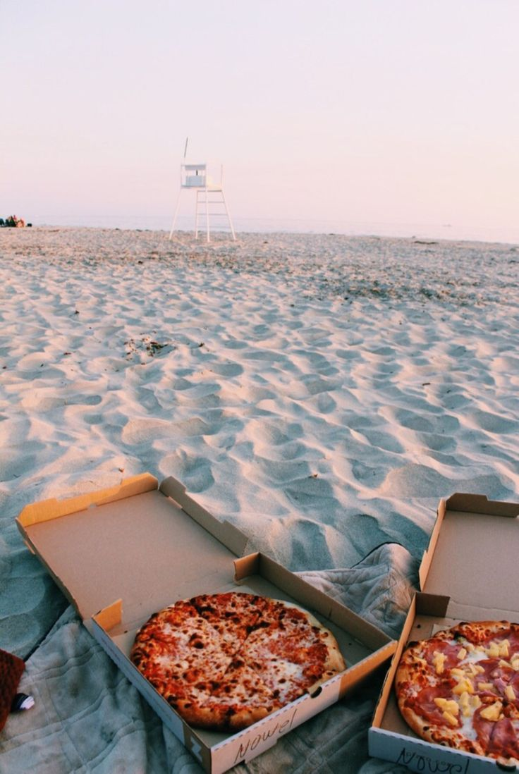 Pizza on the beach at sunset. The perfect summer night!