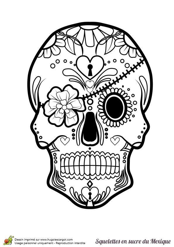 Une tête de mort en sucre mexicain à colorier avec son bandeau de fleur.