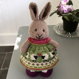This dress was knit with a long tail cast on of 100 stitches and 5 repeats of the chart shown. The hearts were done in duplicate stitch.  I followed my usual modifications for a full skirt found he...