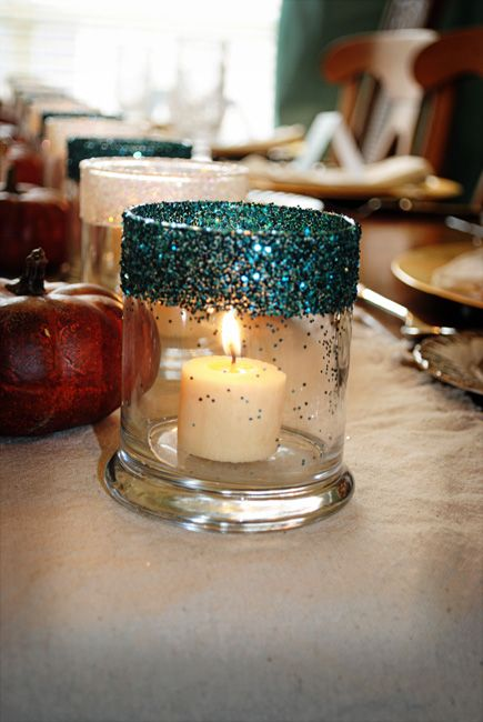 For a touch of sparkle that won't break the bank, paint glitter on the top of your candleholders with some glue! Match the glitter to your wedding or event's color scheme.