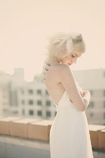girly and feminine tattoos - back tattoo