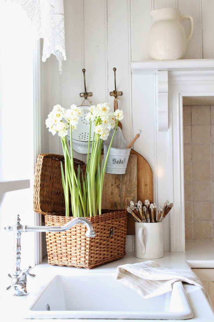 bread board, basket of daffodils, mantel above stove