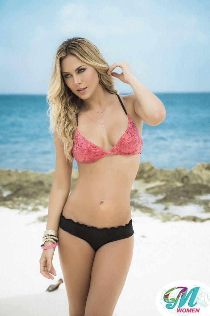 A slitheringly sexy snakeskin print makes this coral and black bikini a get-noticed look! The cups and the back show off the wild print, and the top features four skinny black straps along the sides. The ruffled low rise brief bottom is solid black and has a ruched rear. $28.00