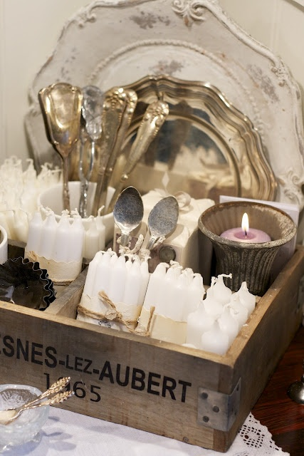Great way to display my grandmother's silver, vintage butter molds, etc.