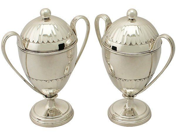 'Antique Preserve Pots in Sterling Silver' http://www.acsilver.co.uk/shop/pc/Pair-of-Sterling-Silver-Preserve-Pots-Antique-George-V-51p9461.htm