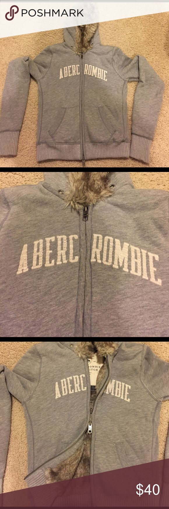 Great condition Abercrombie and Fitch jacket Jacket from Abercrombie and Fitch fur jacket. Fur is lined all inside the coat and hood minus the sleeves. Only thing missing is drawstrings at hood. In great condition and great for the cold days. Size large fits a medium Abercrombie & Fitch Jackets & Coats