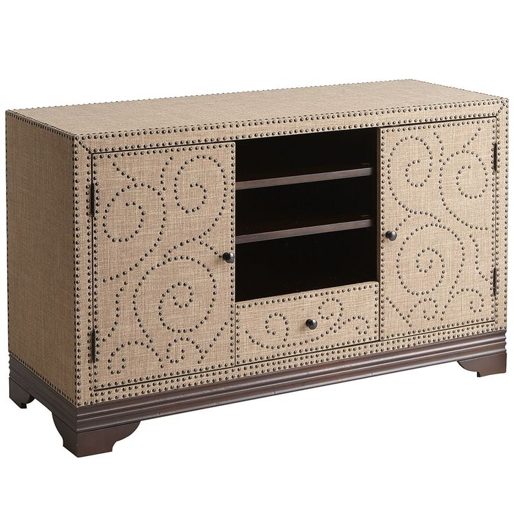 """Clad in luxe-looking linen fabric atop a solid wood base, our cocoa-colored TV stand features ornate nailhead trim and plenty of space to organize your media. Stylish storage with classic good looks and discreet wire management. Accommodates up to a 55"""" flat screen TV."""