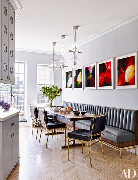 Gracing one wall of the kitchen are several photo-based works by Walead Beshty; the Bethan Laura Wood pendant lamps are from Nilufar, and the custom-made BDDW table is surrounded by vintage Mathieu Matégot dining chairs and a banquette by Rafael de Cárdenas in a Holly Hunt leather.