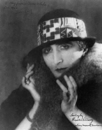 """""""Rrose Sélavy"""" (aka Marcel Duchamp). 1921. Photograph by Man Ray. Art Direction by Marcel Duchamp. The name is a pun in French -- sometimes identified as """"Eros, c'est la vie"""" (Eros is life) & sometimes as """"Arroser la vie"""" (Drink to life)"""
