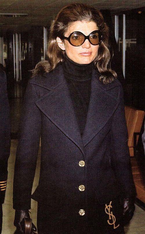 Jackie O style: designer coat, classic black turtleneck, and signature sunglasses