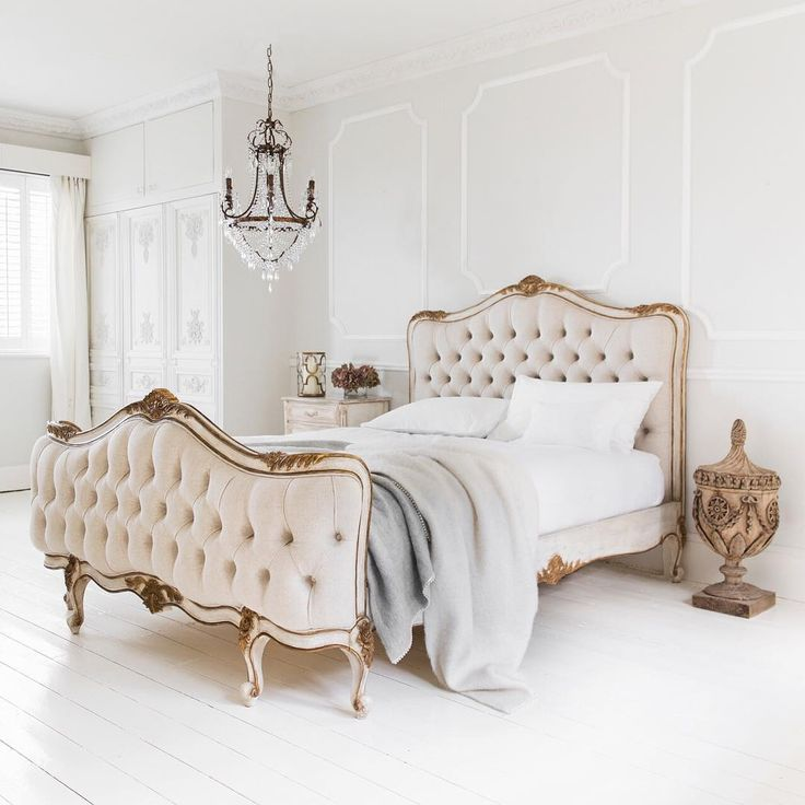french bedroom with cream shapely bedhead and bed end, gold trim, glass chandelier