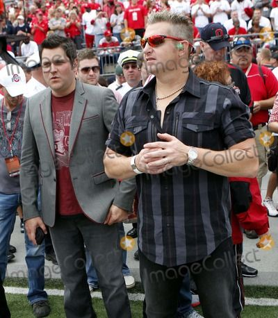 Sept 11, 2010 - Columbus, Ohio, U.S. - JAY DeMARCUS, left, and GARY LeVOX, right, of Rascal Flatts stands on the sidelines before the Ohio State-Miami college football game Saturday, Sept. 11, 2010, in Columbus, Ohio. (Credit Image:  Terry Gilliam/ZUMApress.com)