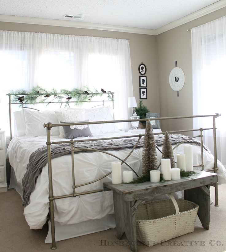Love the greenery on headboard, and I will never get tired of the Target pinched pleat white comforter. :)