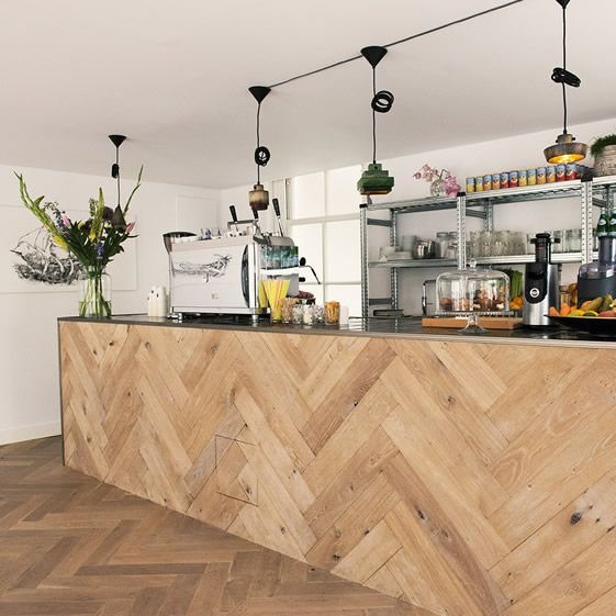 The marketing specialists have been on a barista course to bone up on the bean grinding, using a mezzanine level of their business premises to house a serving counter clad in the same chunky wooden herringbone as the floor, with the remainder of the public area devoted to relaxed café lounge seating...